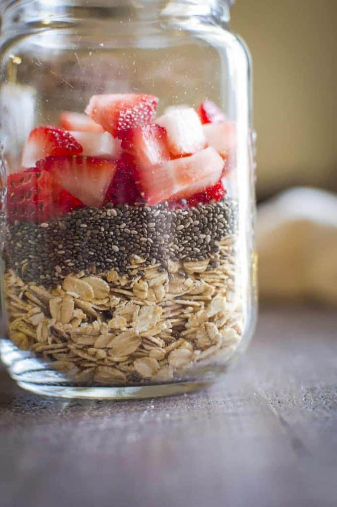 The dry ingredients for overnight oats in a mason jar