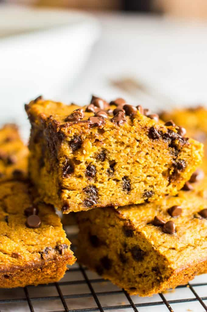 Sweet potato chickpea blondies on a cooling rack, stack on top of one another.