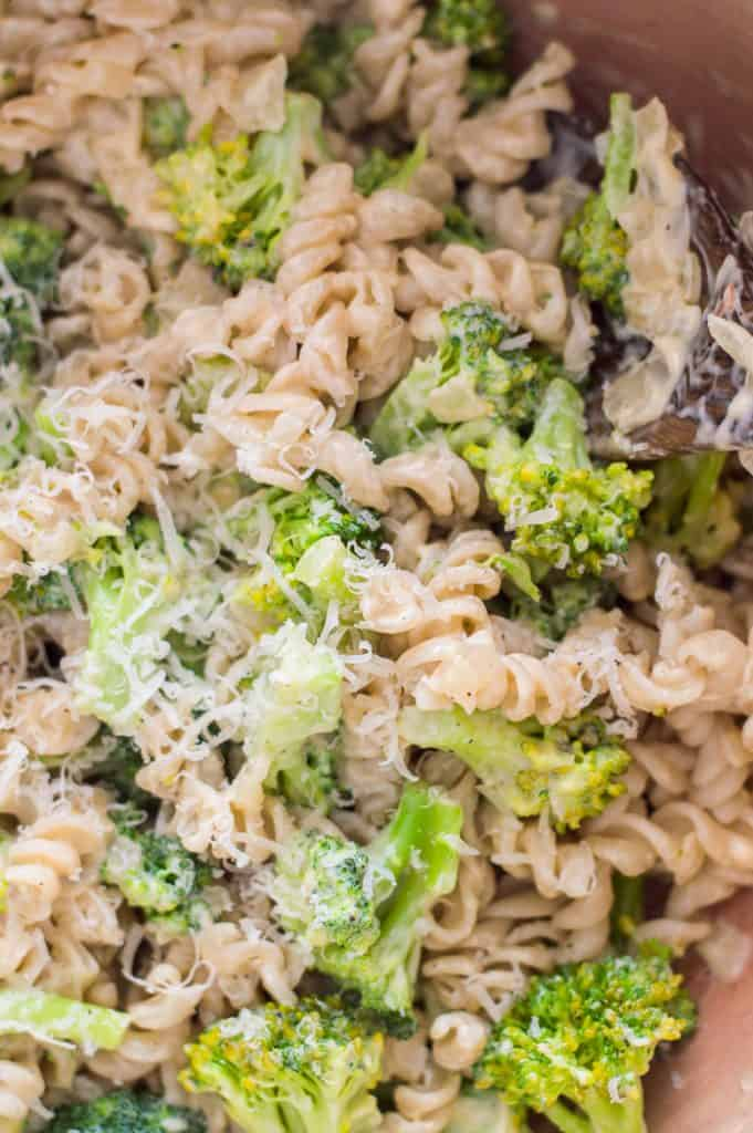 Creamy broccoli pasta after it has been cooked with grated cheese on top.