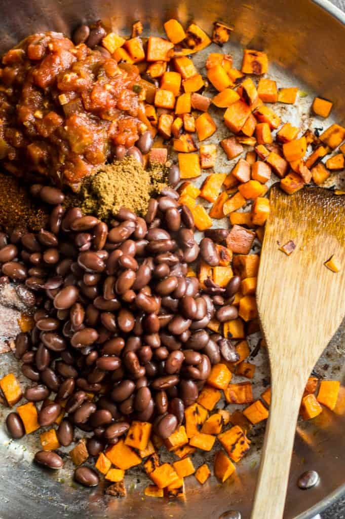 The ingredients for sweet potato black bean quesadilla in a skillet before mixing.