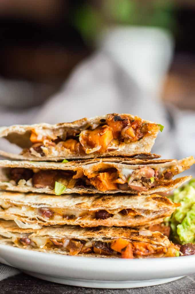 sweet potato black bean quesadilla cut into pieces and stacked on  plate.